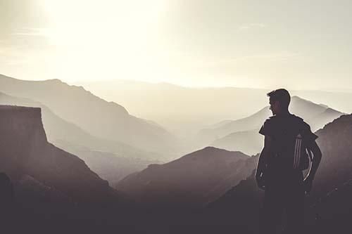Hiker overlooking mountains